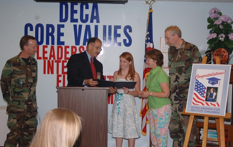 April Taylor, daughter of Maj. William Hubbard, was awarded the Defense Commissary Agency Scholarship for Military Children Tuesday. She is pictured here with Colonel Eugene Willett, 14th Mission Support Group commander, Keith Laughinghouse, CAFB DeCA representative, and her parents, Maj. and Mrs. Hubbard. Ms. Taylor is a senior at  Lipscomb University in Nashville, Tenn., where she is majoring in social work. (U.S. Air Force Photo/Airman 1st Class Danielle Powell)