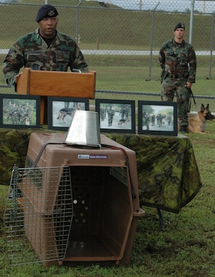 ANDERSEN AIR FORCE BASE, Guam - Staff Sgt. Roberto Cheeseboro, a 36th Security Forces Squadron military working dog handler, speaks about his time as Freddy's dog handler during a memorial service Thursday at the 36th SFS kennels. The service honored Freddy's, a military working dog, service to the Air Force after he recently died of unknown causes. Throughout his time at Andersen, Freddy spent an unprecedented 723 hours conducting foot patrols in the jungles here and is credited with scouting and locating three unauthorized armed personnel. He participated in 16 wing-level exercises, performed multiple demonstrations and he and Sergeant Cheeseboro were the first dog team utilized by the 36th SFS to implement integrated-base defense. A permanent memorial will be built near the kennels to honor Freddy and future military working dogs. (U.S. Air Force/Staff Sgt. Chris Powell)