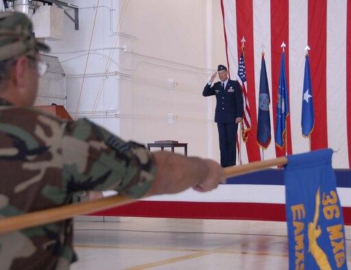 Senior Master Sgt. Mark Gonzales, lowers the 36th Maintenance Group's guidon as Col. Bret Klassen assumes command May 24.  (Photo by Airman 1st Class Daniel Owen/36 CS)