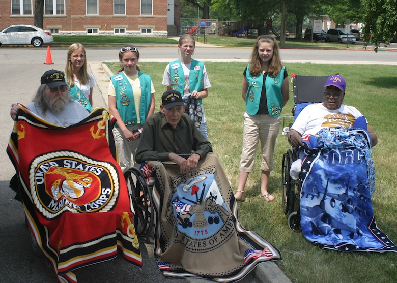 DAYTON,Ohio-- Veterans at the Dayton VA Medical Center are presented with blankets that were sewn by Girl Scout Troop 364 from Lima, Ohio. The Girl Scout Troop presented the veterans with more than 15 blankets and pillow cases that represented all four branches of the armed services. (U.S. Air Force photo/Master Sergeant Doug Moore)