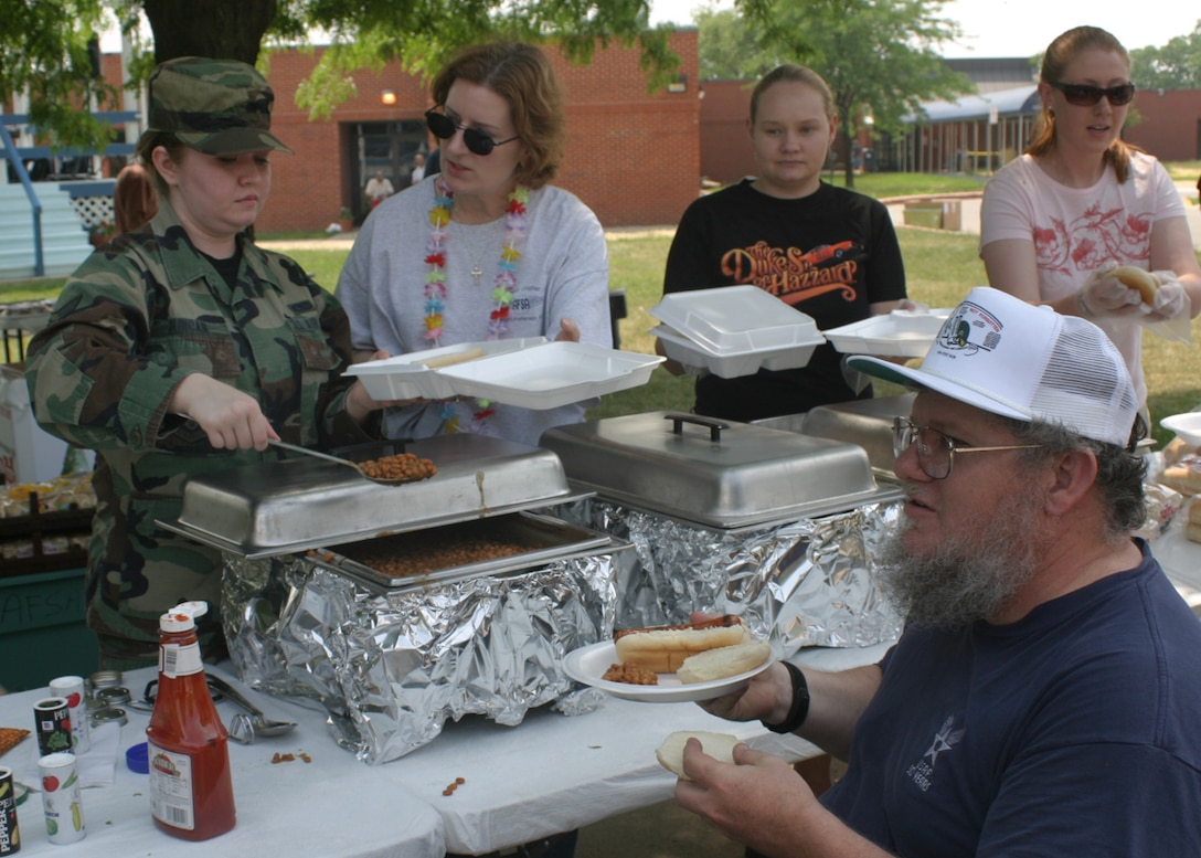 DAYTON,Ohio-- Senior Airman Amanda Duncan, 445th Maintenance Operations Flight, serves food to a veteran during the AFSA Annual Picnic.  The AFSA holds two events at the Dayton VA Medical Center every year to show their support for the veterans. (U.S. Air Force photo/ Master Sergeant Doug Moore)