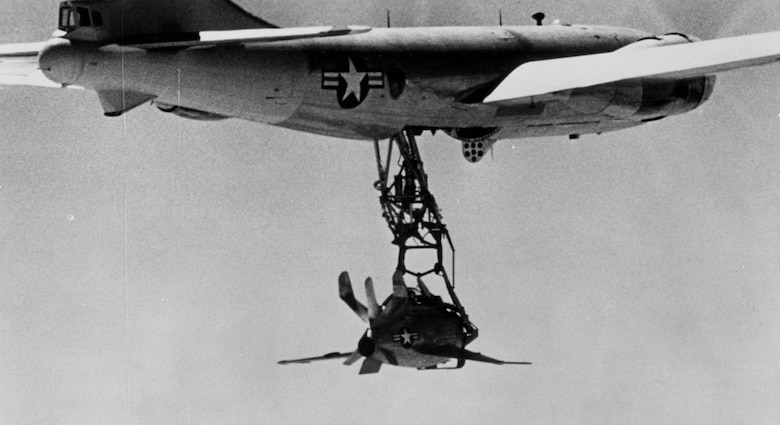Although the XF-85 handled well, the test pilots reported that the airflow around the parent aircraft made it difficult to attach the hook to the trapeze. (U.S. Air Force photo)