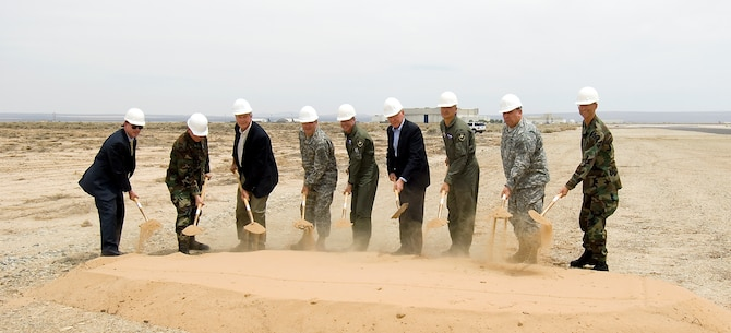 Edwards leadership, the U.S. Army Corps of Engineers and guests shovel dirt during a groundbreaking ceremony June 1 marking the beginning of a new runway project here. (Photo by Mike Cassidy)