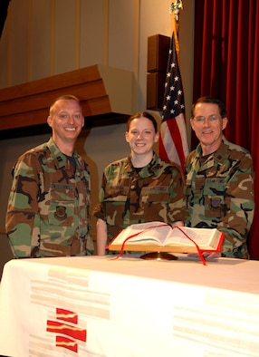 FAIRCHILD AIR FORCE BASE, Wash. -- Chaplain candidate, 2nd Lt. Nicole Palmeira, stands alongside Chaplain (Capt.) Mark Williams and Wing Chaplain (Lt. Col.) Jeffrey Neuberger on the alter at the base chapel. Both chaplains have played a role in guiding the candidate toward chaplaincy. The lieutenant will soon complete her tour here, one of the two required tours for a chaplain candidate. (U.S. Air Force photo/ Airman 1st Class Kali L. Gradishar)