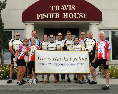 """Mr. Robert K. Rodweller, pictured here (front, far right) in front of the Travis Air Force Base Fisher House, on the second day of his """"2007 Bicycle America for Wounded Veterans"""" cross country bicycle ride. Pictured with Mr. Rodweller are several of his riding partners and members of the Travis Hawks Cycling Club. Mr. Rodweller departed from San Francisco on June 3 to begin a 4,000 mile bicycle ride across our great country. Fifty-two days later on July 25, he will end his ride at Portsmouth, New Hampshire. He is dedicating his ride to the men, women and families of the Armed Services of this country by raising funds for the Fisher House Foundation. (USAF Photo by David W. Cushman/DAFC)"""