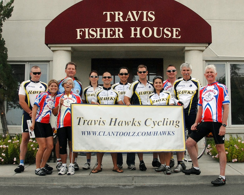 "Mr. Robert K. Rodweller, pictured here (front, far right) in front of the Travis Air Force Base Fisher House, on the second day of his ""2007 Bicycle America for Wounded Veterans"" cross country bicycle ride. Pictured with Mr. Rodweller are several of his riding partners and members of the Travis Hawks Cycling Club. Mr. Rodweller departed from San Francisco on June 3 to begin a 4,000 mile bicycle ride across our great country. Fifty-two days later on July 25, he will end his ride at Portsmouth, New Hampshire. He is dedicating his ride to the men, women and families of the Armed Services of this country by raising funds for the Fisher House Foundation. (USAF Photo by David W. Cushman/DAFC)"