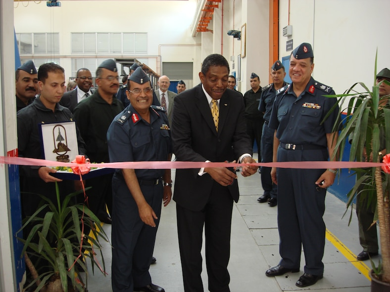 Larry Jones, center, Pratt and Whitney vice president for Military Customer Support, cuts the ribbon to activate the Egyptian air force F100 Engine Depot in Helwan, Egypt. Pictured with him are Maj. Gen. Magdy Gamal, left, Helwan Depot commander, and Maj. Gen. Said Mabrouk, right, chief of the Egyptian air force engineering department.