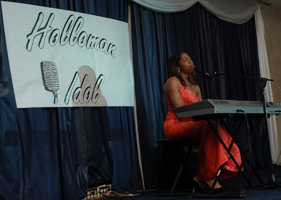 Ashley James sings and plays the piano in front of more than 400 audience members at Holloman Idol. She got second plane in the competition. (U.S. Air Force photo/Airman 1st Class John Strong)