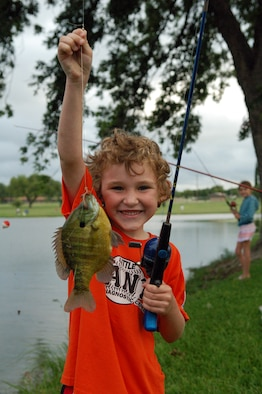 LAUGHLIN AIR FORCE BASE, Texas -- Michael Thompson, 6, son of Lt. Col. Garrett Thompson, 47th Operations Group, displays his first catch of the day.  (U.S. Air Force photo by Staff Sgt. Austin M. May)