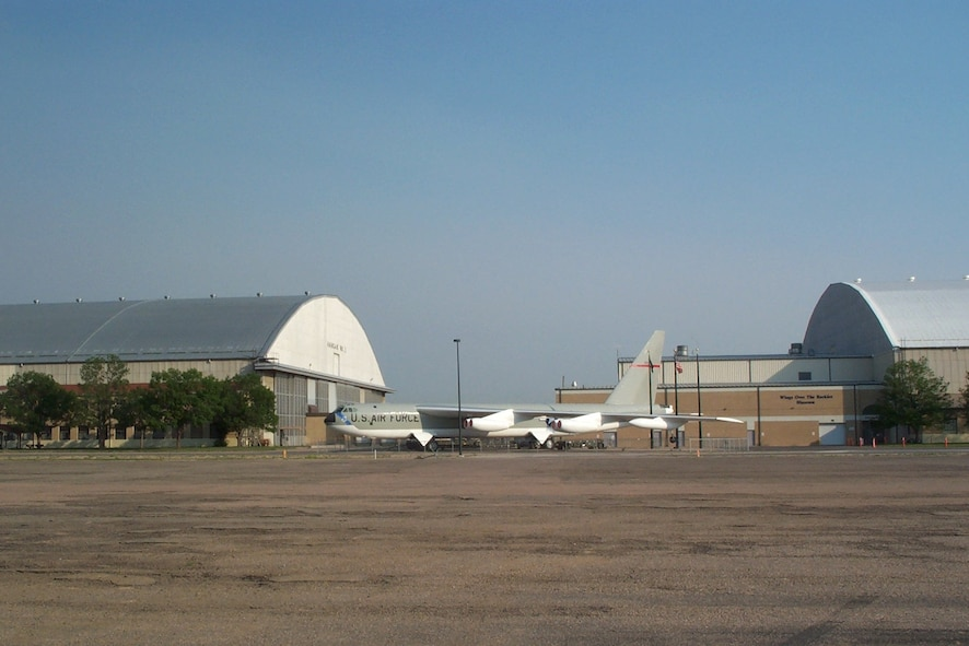 A B-52D bomber sits between Hangars 1 and 2 on the former Lowry AFB, Colo. While there are no longer runways adjacent to these buildings, the hangars are enjoying new life as an aviation museum.