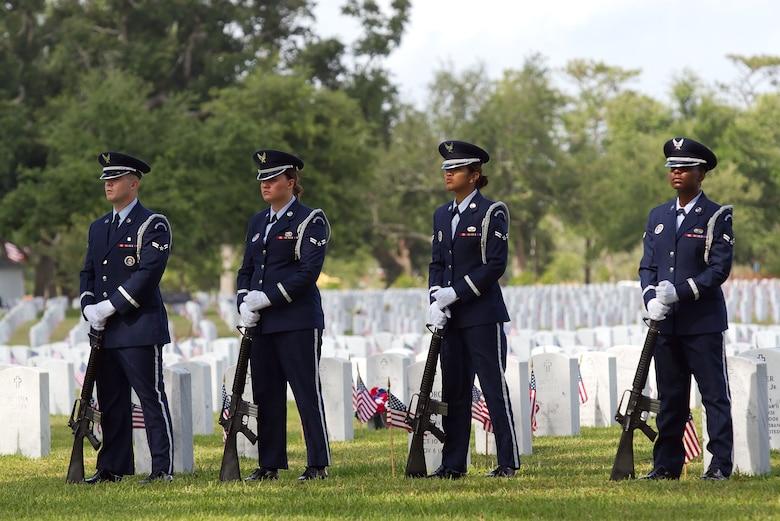 Honor Guard members A1C Timothy Brady, A1C Leslie Whatley, A1C Monik Chhim, and A1C Jazmin Jones at parade rest.  (U. S. Air Force photo courtesy Maj. Aldwin Estrellado)