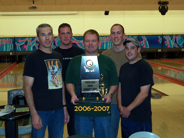 SPANGDAHLEM AIR BASE, GERMANY – The 726th Air Mobility Squadron intramural bowling team clinched the Intramural Bowling Commander's Cup for the second consecutive year May 30. Team members from left to right take a moment to enjoy their victory Gary Grape, Eric Pylka, John Cottle, Jon Bakke and Jeremy Traughber. Additional, team members who helped capture of the trophy include Jason Goul, Greg Todd, Billy Webb, Gillie Zamora, Jerry Wells and Don Latham. (Courtesy photo)