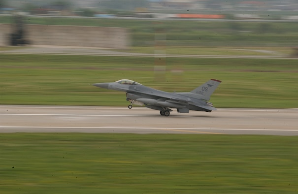 OSAN AIR BASE, Republic of Korea -- An F-16 Fighting Falcon from the 36th Fighter Squadron returns here today after a temporary deployment to Kunsan AB during repairs and maintenance to the air field. (U.S. Air Force photo by Airman Jason Epley)
