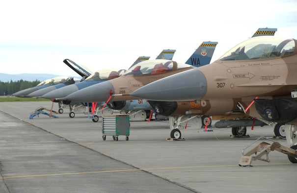 EIELSON AIR FORCE BASE, Alaska -- Six F-16's parked on the flightline prior to a mission for Red Flag-Alaska 07-02 June 5. There are 15 different units currently deployed at Eielson to participate in RF-A 07-02, including members from Singapore's Royal Air Force. (U.S. Air Force photo by Airman 1st Class Christopher Griffin)