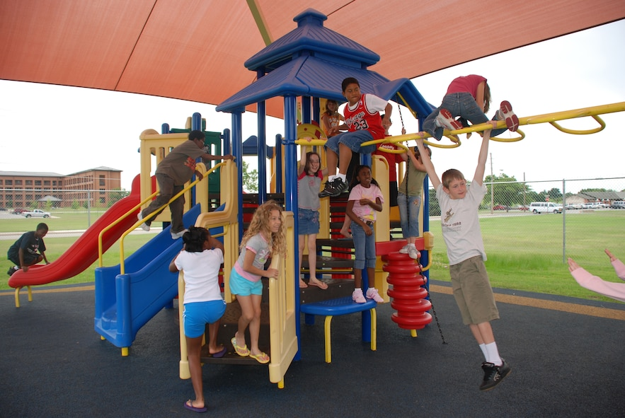 Children attending the Madrigal Youth Center's summer camp play outside on the playground June 4. (U.S. Air Force photo/Airman 1st Class Jacob Corbin)