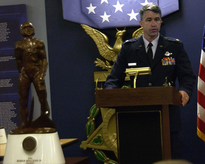 Lt. Col. Peter Byrne thanks his family, friends and coworkers during a ceremony June 5 at the Pentagon's Hall of Heroes. He was awarded the Koren Kolligian Jr. Trophy, which stands in the foreground. Colonel Byrne, the 140th Wing vice commander, earned the award from an incident in June 2006 when he suffered a stroke while flying an F-16 but was able to safely land the plane 90 minutes later.  (U.S. Air Force photo/Staff Sgt. J.G. Buzanowski)