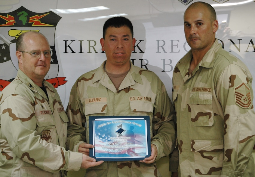 Staff Sgt. Mario Alvarez, 727th Expeditionary Air Control Squadron, receives the 506th Air Expeditionary Group Diamond Sharp Award June 4 from Col. Douglas Tucker, 506 AEG commander (left), and Master Sgt. Ty Jarry, 727 EACS first sergeant, at Kirkuk Regional Air Base, Iraq. Sergeant Alvarez, a Miami, Fla. native, is deployed from Hill Air Force Base, Utah.