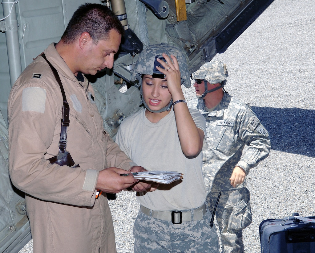 Capt. Chris Capozollo discusses the patient manifest with Army Specialist Renee Castillo June 5 at Forward Operating Base Salerno, Afghanistan, prior to transporting wounded servicemembers to Bagram Air Base, Afghanistan.  Captain Capozollo is chief nurse with the 455th Expeditionary Aeromedical Evacuation Flight and is deployed from the Wyoming Air National Guard's 153rd Airlift Wing.  Specialist Castillo is with the 396th Combat Support Hospital.  (U.S. Air Force photo/Staff Sgt. Craig Seals)