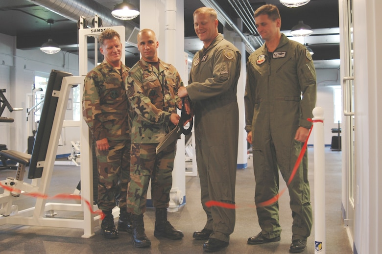 From left to right: Col. Scott Chambers, 75th Air Base Wing commander, Tech. Sgt. Stacey Yeager, assistant civil engineering liaison for the 388th FW, Col. Jeffrey Lofgren, former 388th Operations Group commander, and Col. Robert Beletic, 388th Fighter Wing commander, are all present during the ribbon cutting ceremony to officiate the opening of the pilot gym June 4.