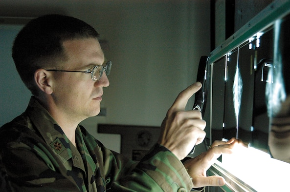 Tinker radiologist, Maj. (Dr.) Jason Wagner reviews mammograms in his 72nd Medical Group office.  Approximately 1500 mammograms are performed here annually. (Air Force photo by Margo Wright)
