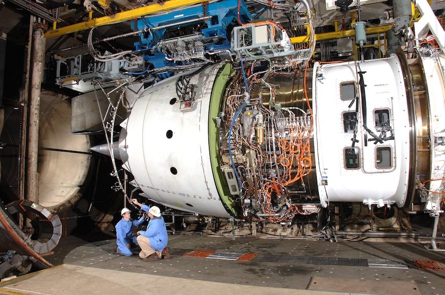 Aerospace Testing Alliance Outside Machinists Danny Haddon and James Cossey inspect the Rolls-Royce Trent 1000 engine in the Aeropropulsion Systems Test Facility at Arnold Engineering Development Center at Arnold Air Force Base, Tenn., prior to testing. (Photo by David Housch)
