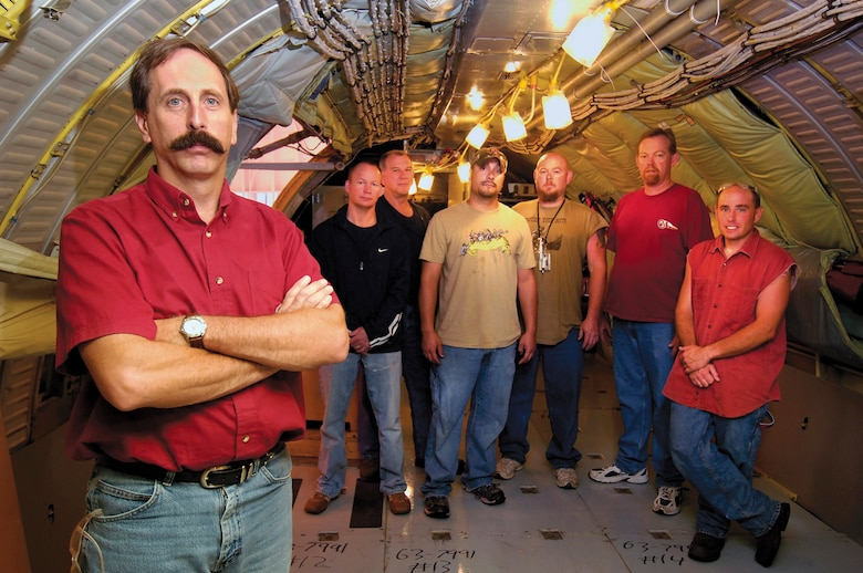 Tinker aircraft planner Brian deFonteny was part of a team who changed the KC-135 cabin pressure testing process, carving days off the flow time and saving the Air Force millions.  Mr. deFonteny stands inside a -135 with mechanics who benefit from the new system.  Back from left are; Darrell McElwee, Clarence Stallard, Josh Massey, Grant Simms, Chuck Drake, and Shane Spencer, who was on the planning team. (Air Force photo by Dave Faytinger)