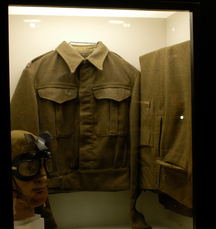 DAYTON, Ohio -- British battle dress and goggles and U.S. flying helmet worn by the donor, Col. Maurice Elstun, on combat missions in North Africa in 1942-1943. When his 93rd Bomb Group was sent from England to Northwest Africa, it was scheduled for only a 10-day period, so most men of the 93rd took few clothes with them. However, the 93rd was soon sent to a base near Torbuk, Libya, for permanent assignment where the only uniforms available were British. These items are on display in the World War II Gallery at the National Museum of the U.S. Air Force. (U.S. Air Force photo)