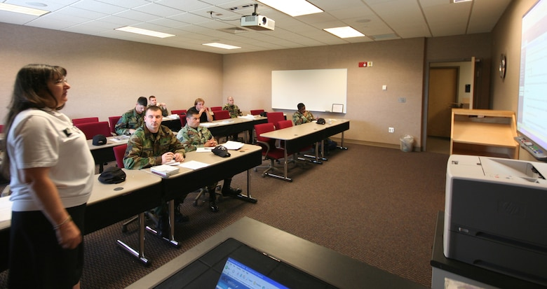 Marge Sokolowski, State Fair Community College, teaches English Composition to members of team Whiteman June 6 at the Professional Development Center. (U.S. Air Force photo/Airman 1st Class Stephen Linch)