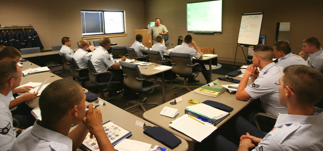 """R.D. """"Smitty"""" Smith, Airman and Family Readiness Center, gives a financial management briefing to the FTAC class 07-J at the Professional Development Center June 6. (U.S. Air Force photo/Airman 1st Class Stephen Linch)"""