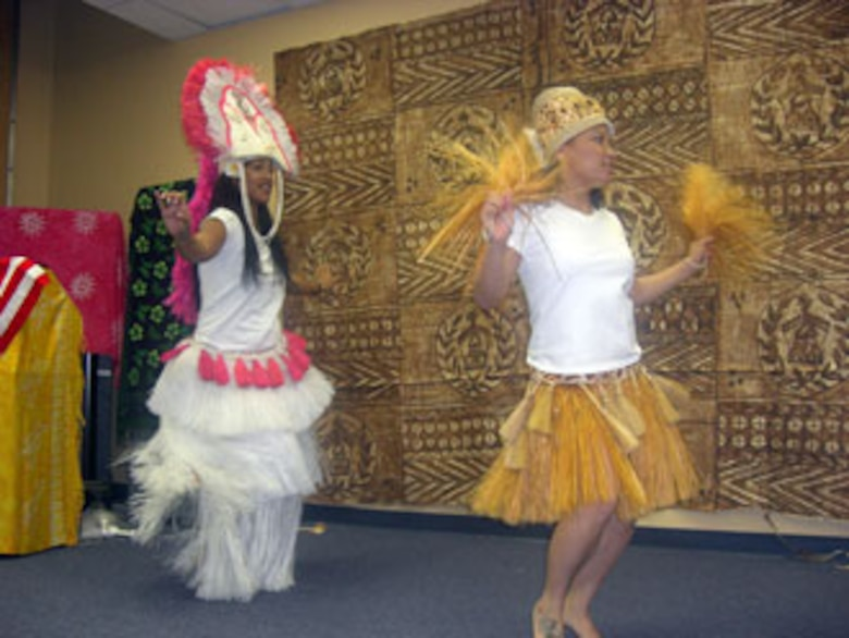 Army Sgt. Mele Semo and Specialist Cat Mai demonstrate a traditional Tahitian dance.  The Army Reserve's 304th Sustainment Brigade held a luncheon at March Air Reserve Base celebrating Asian Pacific Islander month May24. (U.S. Army photo by Specialist Tracy Ellingsen)
