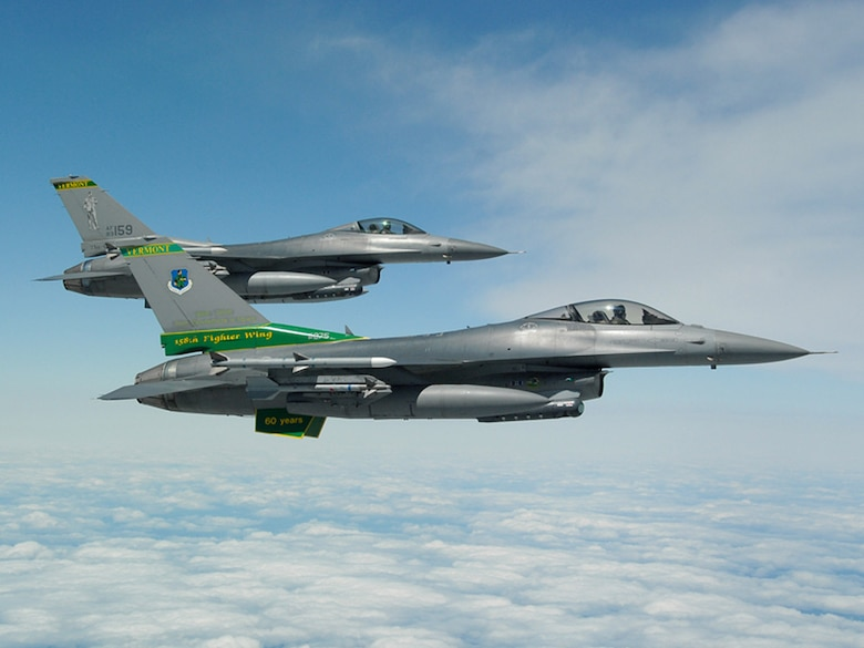Two F-16 Fighting Falcons from the Vermont Air National Guard's 158th Fighter Wing participate in a special event held June 6 to promote Air Force Week New England which will take place in August.  (U.S. Air Force photo/Senior Master Sgt. Robert Sabonis)