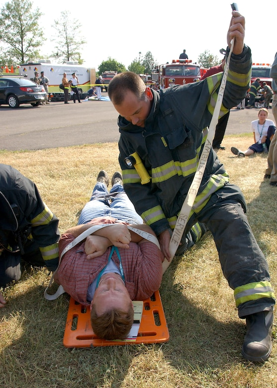 A Rome Fire Department firefighter works to stabilize Northeast Air Defense Sector simulated victim during the Griffiss Park Mass Casualty Exercise Thursday. The exercise challenged first responders to perform their triage and hazmat procedures on victims of a simulated terrorist attack.  Photo by Senior Airman Ricky Best