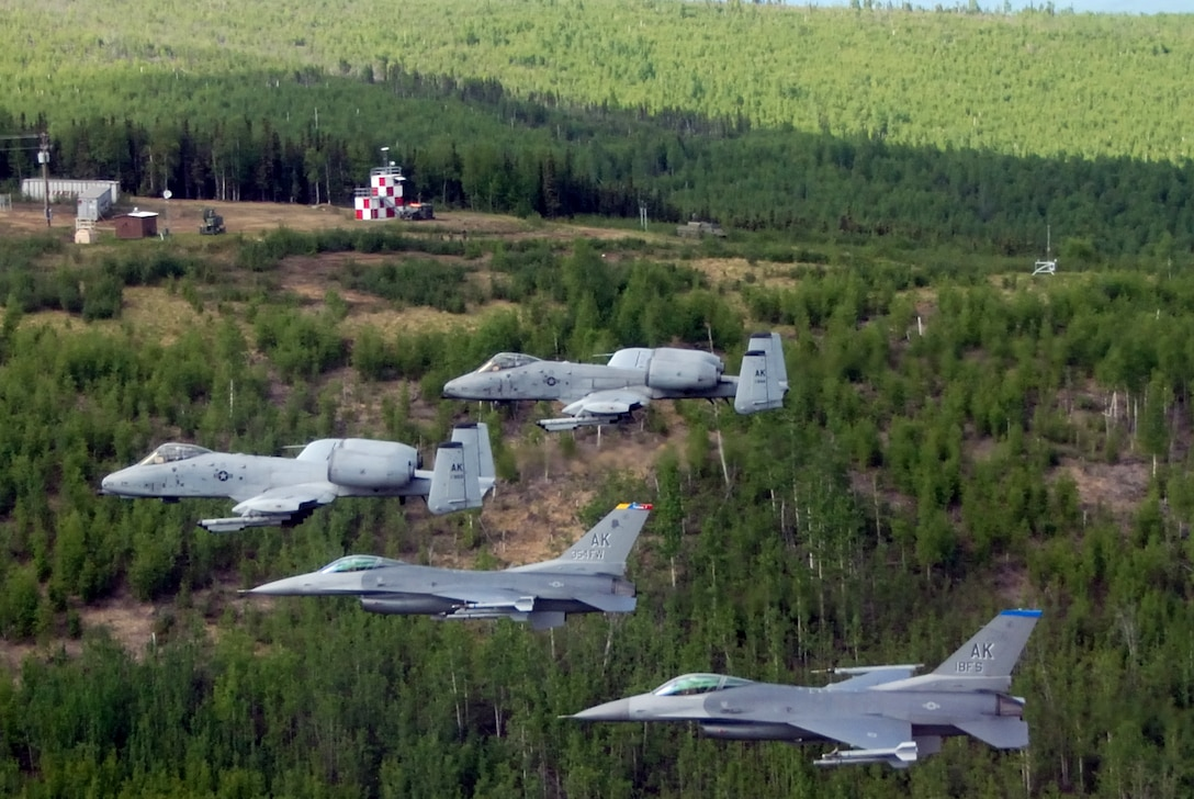 Two F-16 Fighting Falcons from the 18th Fighter Squadron and two A-10 Thunderbolt IIs from the 355th Fighter Squadron fly May 29 over the Pacific Alaska Range Complex in Alaska. The aircraft assigned to Eielson Air Force Base, Alaska, flew in formation for the last time due to the deactivation of the 18th and 355th Fighter Squadrons. (U.S. Air Force photo/Master Sgt. Rob Wieland)