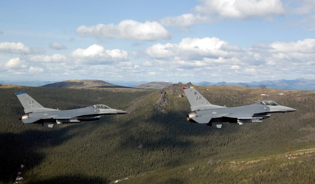 Two F-16 Fighting Falcons from the 18th Fighter Squadron fly May 29 over the Pacific Alaska Range Complex in Alaska. The aircraft assigned to Eielson Air Force Base, Alaska, flew in formation for the last time due to the deactivation of the 18th and 355th Fighter Squadrons. (U.S. Air Force photo/Master Sgt. Rob Wieland)