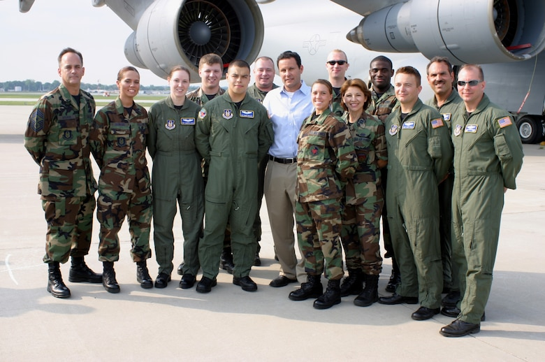 """WRIGHT-PATTERSON AFB, Ohio – Air Force reservists from the 445th Airlift Wing has their photo taken with Brian Kilmeade (center) just after the live broadcast of """"FOX and Friends"""" on June 8.  The show was broadcast from the base's west ramp which is home to the wing's C-5 Galaxy aircraft. (U.S. Air Force photo by Master Sgt. Doug Moore)"""