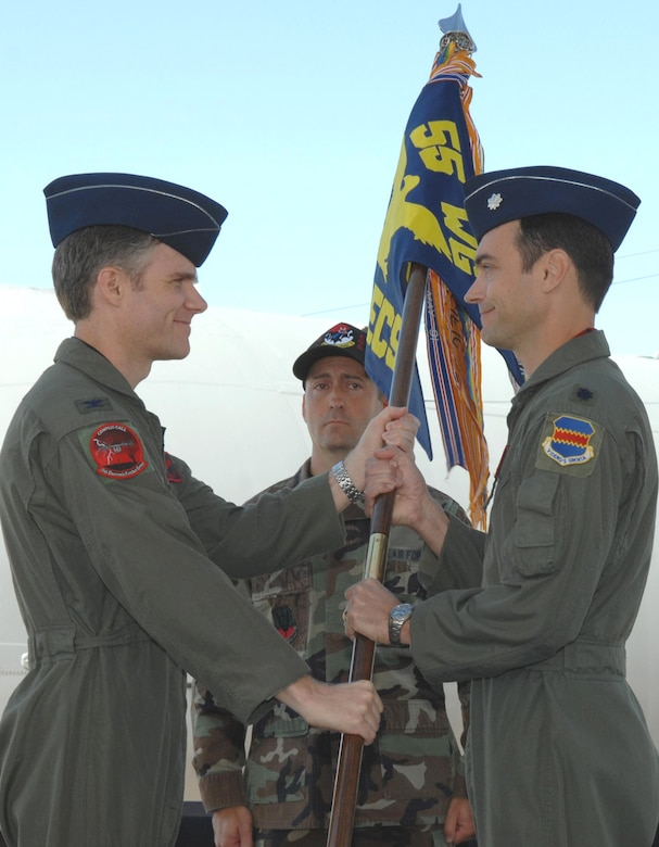 DAVIS-MONTHAN AIR FORCE BASE, Ariz. -- Lt. Col. David A. Delmonaco (right) receives the 43rd Electronic Combat Squadron guidon from 55th Electronic Combat Group Commander Col. Mark S. Haskins during a change-of-command ceremony here June 8. (U.S. Air Force Photo/Airman 1st Class Noah Johnson)