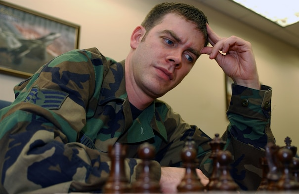OSAN AIR BASE, Republic of Korea -- Staff Sgt. Robert Keough, 607th Air Intelligence Squadron, ponders his next move while teaching another NCO how to play chess here June 8. Sergeant Keough competed at the Armed Forces Chess Tournament June 9-10. (U.S. Air Force photo by Airman 1st Class Jason Epley)