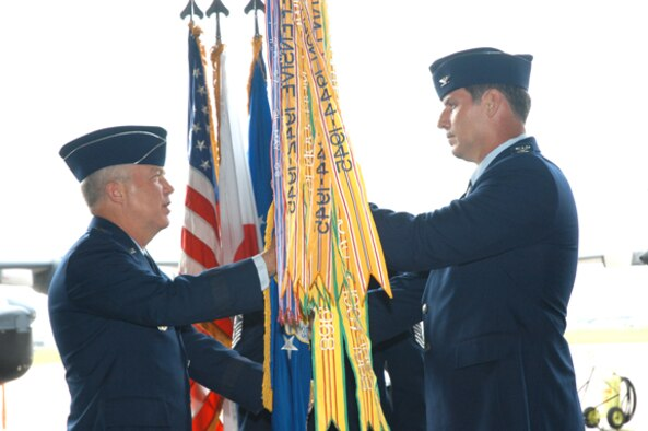 Maj. Gen. Donald Wurster, Air Force Special Operations Command vice commander, passes the 353rd Special Operations Group guidon to Col. David Mullins, incoming 353rd SOG commander, June 8.  The change of command ceremony was held at Kadena Air Base, Japan.  (U.S. Air Force/Master Sgt. Marilyn Holliday)