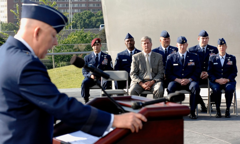 Air Force Chief of Staff Gen. T. Michael Moseley speaks to the crowd before the Air Force Combat Action Medals were presented to six Airmen. They were the first to receive the medal in a ceremony held at the Air Force Memorial in Arlington, Va. (U.S. Air Force photo/Staff Sgt. Brian Ferguson)
