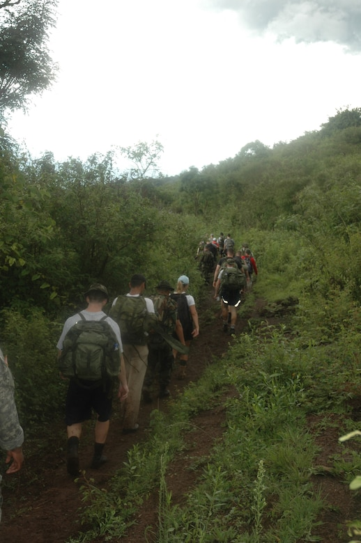 Participants of Iguana Challenge 2007, a two-day march from Tamara, Honduras to Soto Cano Air Base, make their way through the Honduran countryside. The march was a command directed volunteer march for members of Joint Task Force-Bravo and Honduran Military members. The 30-mile march took particpants over the mountains surrouding Soto Cano AB. U.S. Air Force photo by Senior Airman Shaun Emery.