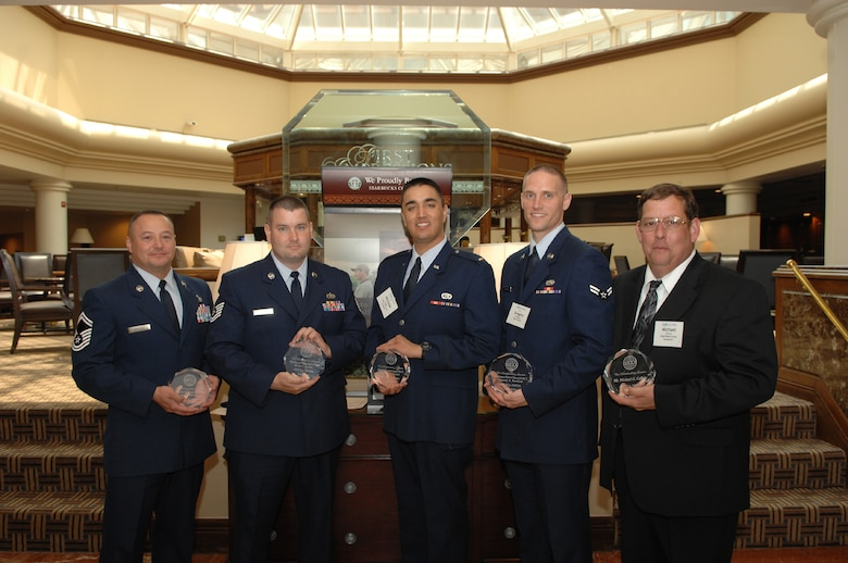 844th Communications Group members (left to right) Senior Master Sgt. Jesus Mireles, Tech Sgt. Keith Knotts, 2nd Lt. Nicholas Gomez, Airman First Class Gregory Benhaze and Mr. Michael Calkins pose for a photo following the award presentations June 8 at the Sheraton at Tysons Corner, Va. (U.S. Air Force photo by Airman 1st Class Timothy Chacon)