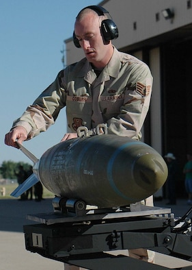 Staff Sgt. William Coburn, 49th Aircraft Maintenance Squadron, places a bomb onto the jammer, the bomb-lift truck, during the weapons load competition at Cannon Air Force Base, N.M. Twenty five Airmen traveled to Cannon for the Pioneer Air Festival where the team took first place with a weapons load competition and bomb drop demonstration. (U.S. Air Force photo/Airman 1st Class Heather Stanton)
