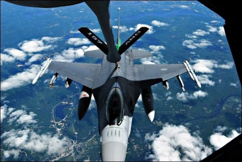John Huff/Staff photographer Major Brian Waters of the Vermont based 158th Fighter Wing positions his F-16 Fighting Falcon for mid-air refueling by one of the 157th Air Refueling Wingís KC-135 tankers Wednesday over New Hampshire.