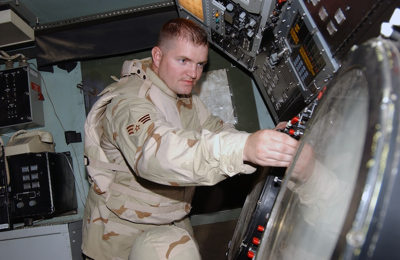 Senior Airman Manchester performs preventative maintenance on a UPA-59 decoder during a daily inspection of one of the TPS-75 air control and warning radar at Balad Air Base, Iraq. Airman Manchester, a 727th Expeditionary Air Control Squadron radar maintenance technician, is deployed from Hill AFB, Utah. (U.S. Air Force photo by Senior Airman Olufemi A. Owolabi)