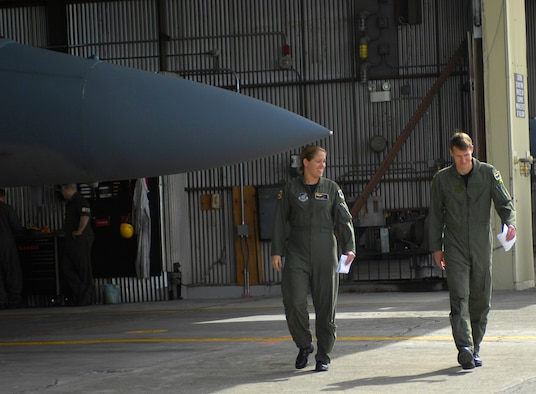 ELMENDORF AIR FORCE BASE, Alaska -- Maj. Carey Jones walks with her husband Capt. Blaine Jones following their flight June 6. The couple became the first husband and wife to fly an alert practice scramble together. Both are members of Elmendorf's 19th Fighter Squadron. (U.S. Air Force photo by Airman 1st Class Tinese Treadwell)