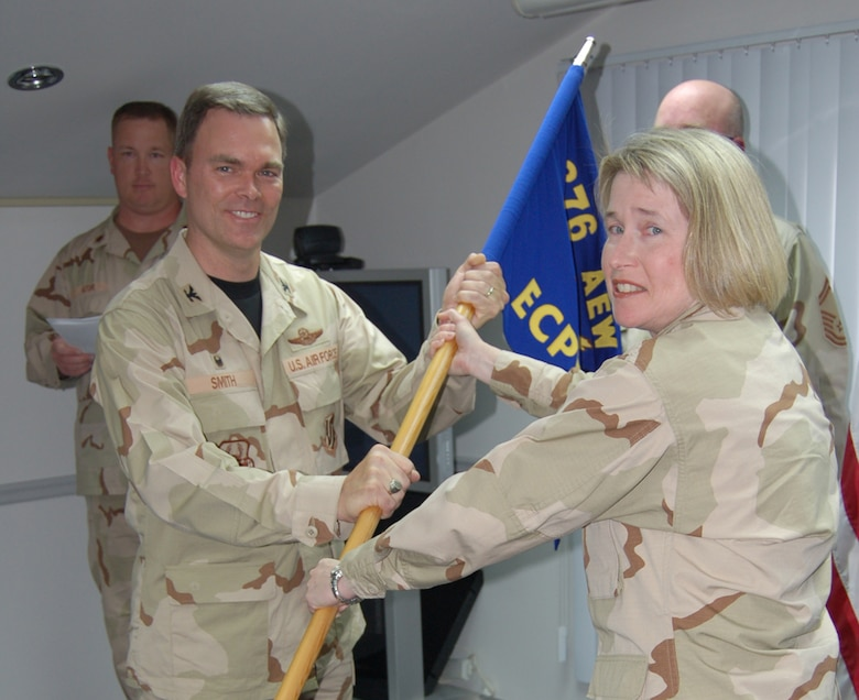 Maj. Gena Stuchbery, 14th Comptroller Squadron, takes the guideon as squadron commander while deployed to the 376th Air Expeditionary Wing. (U.S. Air Force Photo)