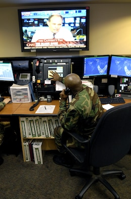 HICKAM AIR FORCE BASE, Hawaii -- Staff Sgt. Lynn Brown works at his control console inside the command post here Friday. Sergeant Brown is an emergency actions controller from the 15th Airlift Wing. (U.S. Air Force photo/ Tech. Sgt. Shane A. Cuomo)