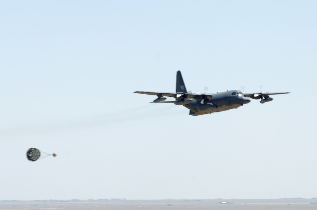 A C-130 from the 1st Special Operations Wing at Hurlburt Field, Fla., does a mock cargo drop as the final event of the Pioneer Airfest. The Pioneer Airfest was held at Cannon Air Force Base June 8 and consisted of a weapons-loading competition and a bomb-dropping competition. (U.S. Air Force photo by Airman 1st Class Randi Flaugh)