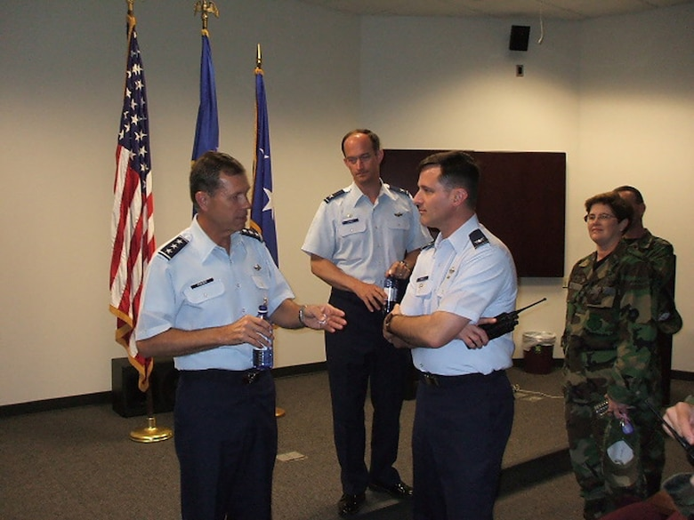 Lt. General William Fraser, Assistant to the Chief of the Joint Chiefs of Staff, conducted a mentoring session for all Airmen at Columbus AFB, Miss. on Thursday.  In this photo, General Fraser discusses Air Force issues with former Vice Wing Commander, 14th Flying Training, Colonel Mark Baker.