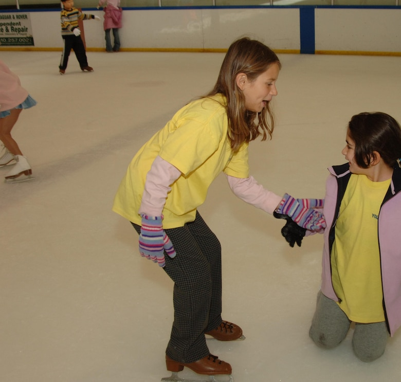 On a youth program trip to a local skating rink, a family member lends a hand to her friend. This summer's camp program includes field trips to Mulligan's Family Fun Center, Mud Park in Huntington Beach, Natural History Museum and the Science Museum.  In addition to the trips, campers will be able to participate in activities such as art projects, science projects, team-building projects, swimming, writing, singing, community service and Fit Factor/sports participation. The summer camp begins June 25.